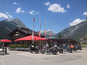 Biker group in front of the AlpenParks Hotel Matrei