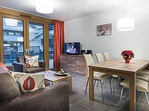 Farbenfroh eingerichtete Ferienwohnung im AlpenParks Hotel