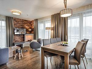Gemütlich eingerichtetes Apartment mit offenem Kamin
