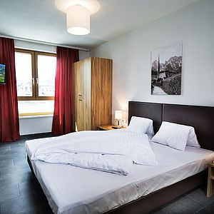 [Translate to English:] Schlafzimmer in der AlpenParks Residenc Zell am See